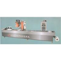 Vacuum thermoforming packaging machine