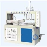 Oven-moving vacuum plastic absorbing machine