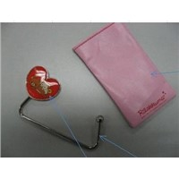 unfoldable bag hanger in heart shape