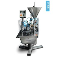 Tube filling and sealing machine for plastic and laminated tubes