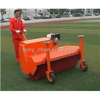 Brushing machine for artificial turf