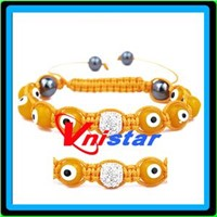 Shamballa evil eye bracelet with yellow glass bead