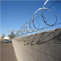 Razor wire-long-barb type on top of a chain link privacy-fence