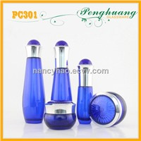Blue cosmetic glass bottles and jars