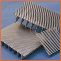 Sloped plate coalescers