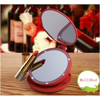 Portable plastic travel mirror for makeup with LED lighting, powered by AAA battery