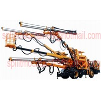 Jumbo drill for underground mining or tunnelling with three arms