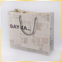 Recyclable Newspaper Style Shopping Packaging Customized Craft Paper Bag for Wholesale