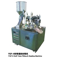 Laminated tube filling & sealing machine