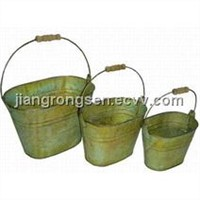 Antique green of oval tin bucket