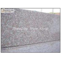 peach red granite slabs