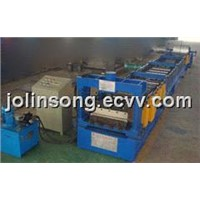 Steel deck floor forming machine