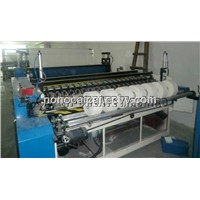 Jumbo roll paper slitting and rewinding machine