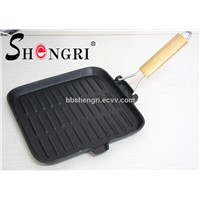 cast iron frying pan with folding wooden handle