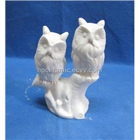 Porcelain Owl Figurines Perched on Stand