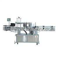 Round flat bottle labeling machine