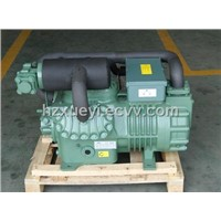 Two stage refrigeration compressor