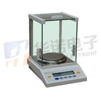 Electronic balance with standard weight and periodic calibration