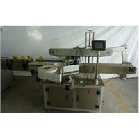 Two sides labeling machine for flat bottle