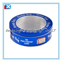 small round tin container/ biscuit can