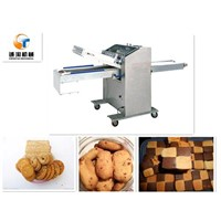 Cookie slicing and aligning machine