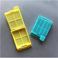 Disposable plastic embedding cassette