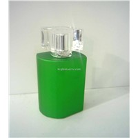 glass perfume bottle with green cover