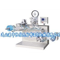 Automatic packing film labeling and rewinding machine