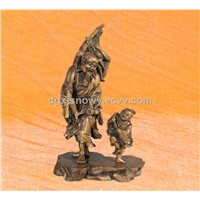 Traditional handmade wood sculpture with fisherman