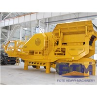 Mobile tire ore crusher station