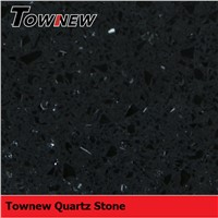 Black with specks of mirror and glasses quartz surface countertop sample