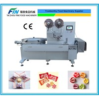 Automatic pillow type candy packaging machine