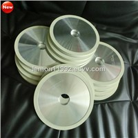 Ceramic diamond bruting wheels for natural diamond processing