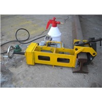 electric/internal combustion rail drilling machine