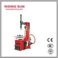 Semi automatic tire changing machine with swing arm