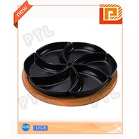 black ceramic food holder in windmill shape