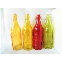 Glass bottle with colored and apple shape