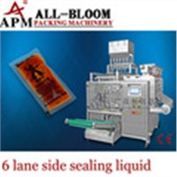 Multi lane liquid filling and packing machine