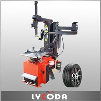 Automatic flip tire changer machine with help arm for car