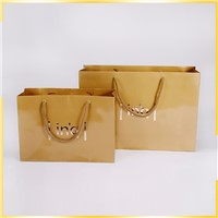 Factory Price Luxury Customized Gold Hot Stamping Shopping Wedding Gift Paper Bag by China Manufactures